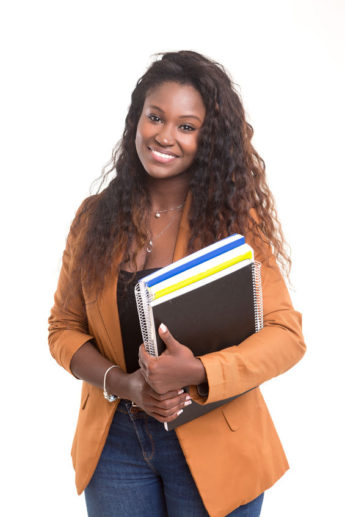 39902379 - beautiful african student woman posing isolated over white background